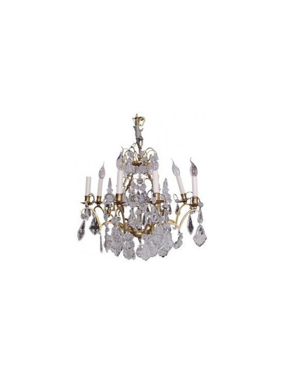 ARTISAN ANTIQUE CHANDELIER - Originally acquired from Artisan Lamp Co., a nationally recognized dealer of fine antique lighting and fixtures in Washington, DC, this brass and crystal chandelier is an iconic piece. Each tier drips with hand carved crystal of various sizes and shapes, and its highly stylized curved brass branches hold eight elegant candelabras for the perfect amount of light. This piece is in good antique condition.