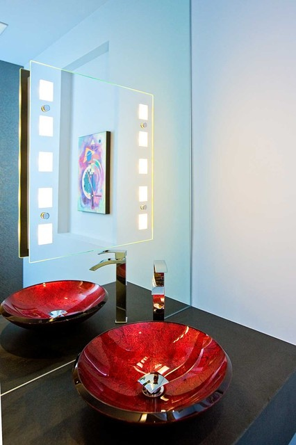 Elegant powder room with red sink and lighted mirror modern