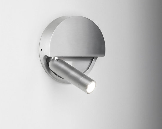 Marset - Ledtube Round Left Wall Sconce - Ledtube Round Left Wall Sconce comes in Aluminum, White, or Black. Available in a right and left version. The LED light comes on automatically when opened out and goes off when closed. The 180 degree rotation makes it ideal for installing on any wall. One 3 watt, 120 volt 3000K 95 lumens 80CRI LED module is included. ADA compliant. UL listed. 5.2 inch width x 5.2 inch height x 1.3 inch depth.