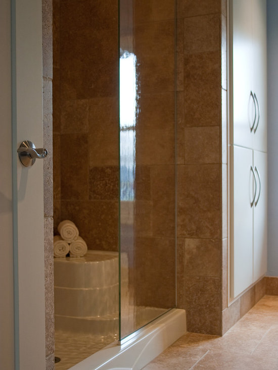 """Considering Carpet? Roll Out the Stone Instead! - Bath Shower.  NSVI """"Windsor"""" stone travertine floor."""
