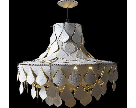 Let it Rock - White Crocodile by O'Hare & D'Jafer - This stunning chandelier is hand cut and sewn with leather throng stitching. The seams are accessorized with chrome studs and spikes. The interior of the chandelier is finished in a gold foil. A wonderful ambience is created when the chandelier is turned on and all the hardware's reflected patterns bounce off the walls.