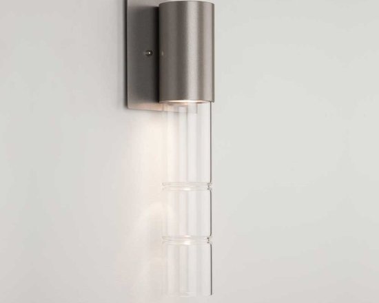 Hammerton - Bamboo Down Light Wall Sconce - Bamboo Down Light Wall Sconce is available in a Metallic Beige Silver or Flat Bronze finish with Clear glass. The Bamboo collection pairs sparking smooth columns of fire polished glass with beautifully finished metalwork to achieve a sleek, sophisticated contemporary aesthetic. American artisans carefully hand-form and craft each piece of bamboo glass to achieve its distinctive luminous quality. Our broad selection of Bamboo fixture styles lets you showcase this remarkable look in surprising ways throughout your home. One 35 watt 120 volt MR16 medium base halogen lamp is required, but not included. ADA compliant. UL listed for dry locations. 5.5 inch width x 14.6 inch height x 3.2 inch depth.