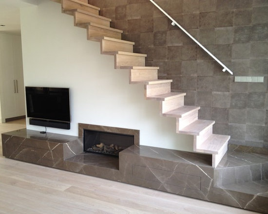 Natural stone fireplace - An exclusive custom made fireplace. A piece of art as well. This company specializes in 'gadgets' in natural stone solutions, like the fronts of the drawers.