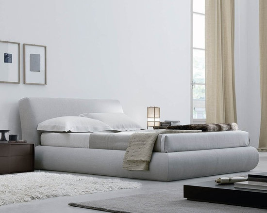 Baldo Bed - Baldo Bed is designed by crj. Completely upholstered bed with removable fabric or in leather, available with or without storage. Chrome metal basement.
