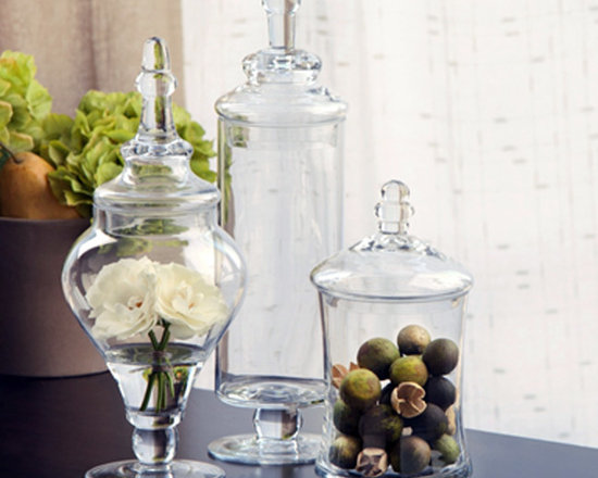 Apothecary Jars (Set of 3) - Apothecary Jars lend versatility to your decorating and the beautiful clear glass makes it the perfect minimalist piece for a transitional living space. Use to showcase florals, shells, or sand. Use at the holidays for treats. The jars are made of transparent fine glass.