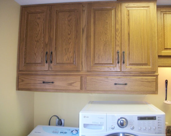 Laundry Room Remodel, Wellington, OH #1 - This laundry room was updated using Custom Wood Products cabinets In Oak, Cambria Canterbury countertops, Blanco Diamond Granite Sink and Duraceramic Rapolano Desert Chimney flooring.