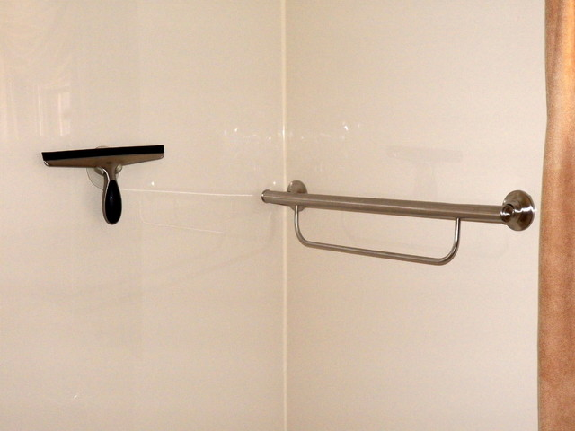 decorative grab bars actually add warmth to this bathroom