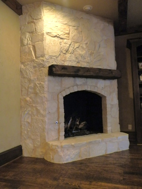 austin stone fireplace traditional family room