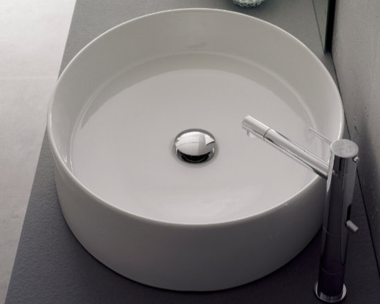 "Scarabeo - Beautiful Circular Contemporary White Ceramic Vessel Sink - Beautiful circular contemporary bathroom sink made out of high quality white ceramic. This above counter vessel sink comes without overflow and has no faucet holes. Designed and manufactured in Italy by Scarabeo. Sink dimensions: 21.30"" (width), 5.30"" (height), 17.70"" (depth)"