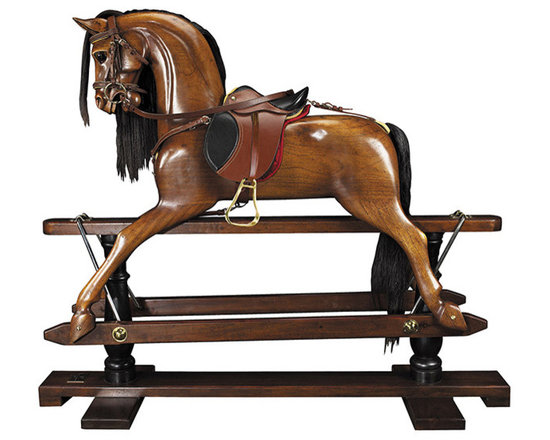 """Inviting Home - Victorian Rocking Horse - Victorian rocking horse 56"""" x 18-3/8"""" x 47-1/2 Younger sons born into nobility or the gentry were often sent to serve at the Royal Court as pages of honor. Part of their education was learning tournament jousting. The master-at-arms used wooden horses mounted on swings to teach skills with sword and lance. This wooden horse evolved over time into the classic rocking horse. No upper class children�s playroom was without one. Some were mounted on oval wood rockers others on a 'safety' stand where steel swings allowed for greater movement on a stationary base. Our iconic rocking horse is a full-sized reproduction of originals dating back to the 19th C. Victorian rocking horse is hand carved in top quality mahogany. Hand made saddle and tack of real bridle leather. The expert skills of wood carvers cabinetmakers and saddlers are evident. Hand finished in a warm and glowing French-style varnish slightly distressed to make it look somewhat aged. A timeless treasure and a dream-toy for both boys and girls. Imagine its value in 50 or 100 years!"""