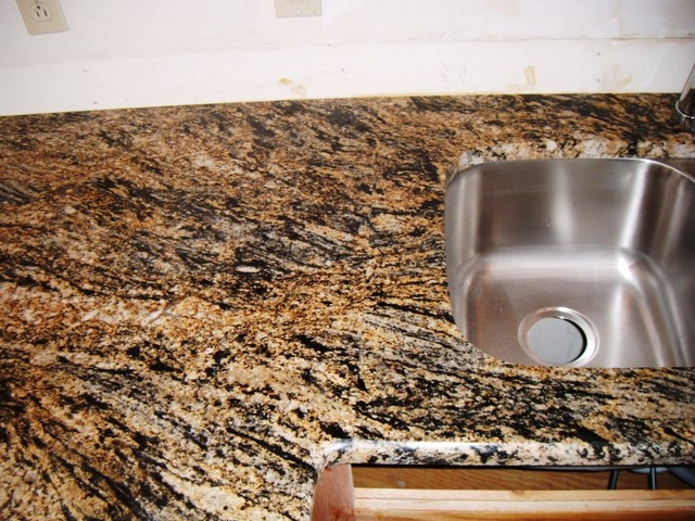 STORMY NIGHT GRANITE For Oak Cabinets Traditional
