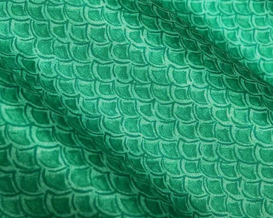 """Island Safari Fabric in Seafoam Green - Island Safari Fabric in Seafoam Green is a scale printed discounted fabric in a bright green-teal hue, perfect for upholstering projects. This happy fabric is sure to add cheer to your home and works wonderfully for tropical/beach themed interior designs. Reminiscent of a mermaid's tail! 100% polyester with a width of 62″. Repeat: V 27"""" H 27"""". This fabric has fire rating and passes 30,000 Double Rubs abrasion test. Machine washable with warm water."""