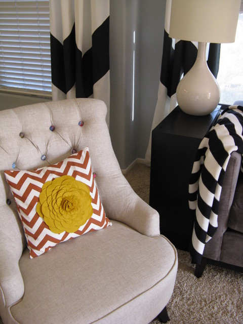 Button Tufted Chair and Chevron Pillow eclectic