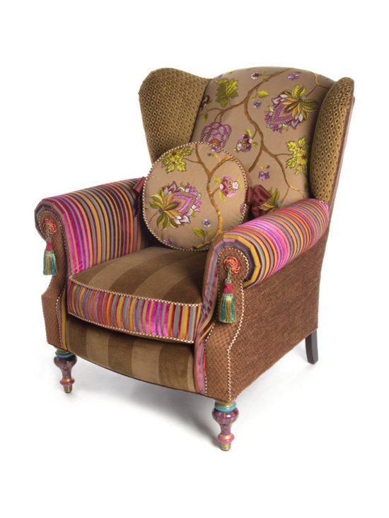 Bittersweet Wing Chair | MacKenzie-Childs - A classic shape, offering outstanding comfort and unparalleled style. Upholstered in a charming pastiche of rich patterns: vibrant jewel-toned velvet stripes, plush chenille velvets in olive and coffee shades, plum and chocolate checks, and a dreamy embroidered centerpiece floral. Adorned with passementerie medallions and tassels, checked piping, and multicolored hand-painted accents. Eight-way, hand-tied coil construction; reversible seat cushion has a high-density foam-and-spring core, wrapped with a down-feather blend.
