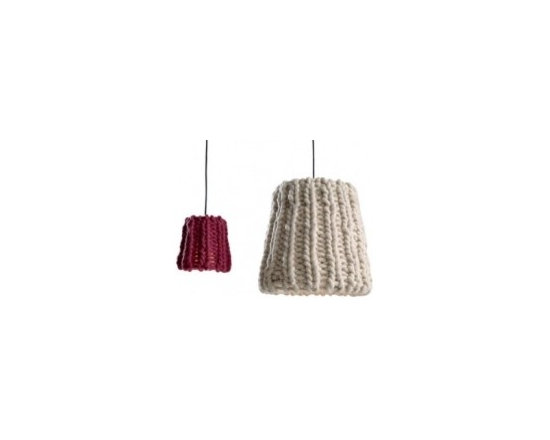 Eco Friendly Furnture and Lighting - Granny is knitting while she listens to your troubles, your newest adventures and heartbreaking stories. Granny gives you a hot chocolate to warm up from cold winter weather. Granny reads out a fairy tale to the children. Granny is a reminiscence of childhood. Granny is made exclusively from Tyrolean wool washed made by Regensburger Gmbh. Each piece is hand-knitted by the cooperative Wandschappen including senior citzens and people with special needs.