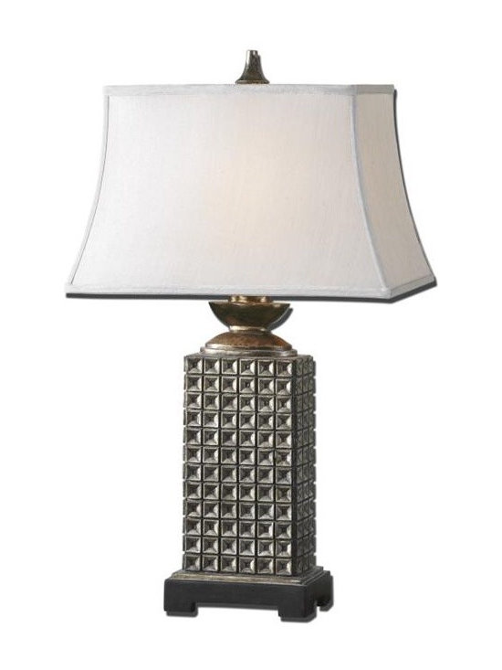 Uttermost Maggia - Heavily antiqued silver leaf finish with a rottenstone glaze, burnished edges and champagne highlights. The rectangle bell shade is a silken light champagne fabric.