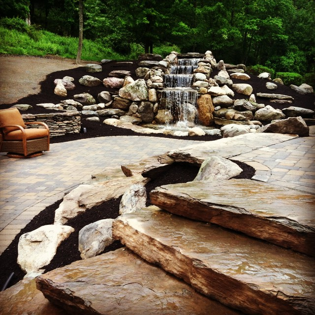 Fieldstone Rock Patios : Waterfall natural fieldstone walls with two tiered paver
