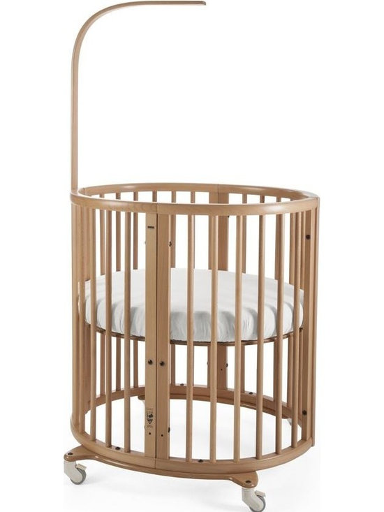 Stokke - Sleepi Mini  Round Crib Cradle, Natural, Mini Crib - Stokke® Sleepi Mini is the perfect first bed for your baby. Its distinctive oval shape provides your baby with a sense of security by creating a cozy nest-like environment. With adjustable height positions as well as the ability to grow with your child, Stokke® Sleepi expands to accommodate the changing needs – and sizes – of the growing child while maintaining a comforting familiarity. The bed creates a small footprint in your nursery while the lockable wheels make it easy to move from room to room. At only 26 inches wide, it is amazingly efficient in even the smallest of spaces.