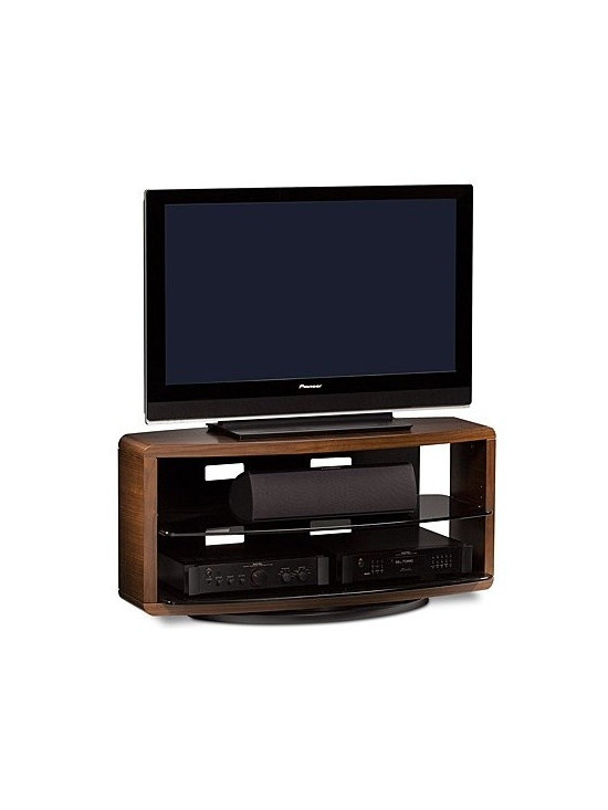 "BDI - BDI | Valera Swivel TV Stand 9724 - The Valera Swivel TV Stand 9724 frames home theater systems with warm wood tones for a semi-enclosed appearance. Accommodate a variety of components with the adjustable, tempered glass shelf while the top shelf will support televisions up to 50"" in size. Corner friendly, Valera features an integrated swivel with a 360°, 30°, and stationary settings that allows the TV to be positioned for the best view.Product Features:  Corner friendly Integrated swivel Three swivel settings include 360°, 30° for corners, and secured in place Cable management system Adjustable shelf Flow-through ventilation Grey tinted tempered glass Supports up to 50"" flat panel TV Component capacity for 4-6 units"