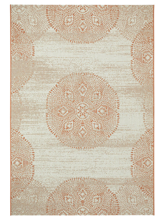 Finesse Mandala rug in Persimmon - Finesse Mandala takes intricate and familiar patterns from centuries old designs and brings it into a landscape ... your backyard.  Why should precious only live inside?  Distressed and seemingly aged, these rugs will add contrast and richness to any deck or patio.