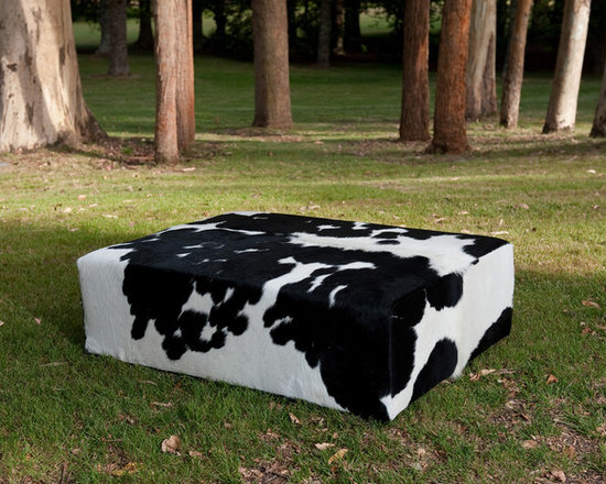 Gorgeous Creatures New Zealand - Black and white cowhide rectangle ottoman - A large rectangle black and white cowhide ottoman 120cm x 90cm x 40cm tall with invisible feet. This gorgeous ottoman needed two cowhide rugs to make it because it was so large. These ottomans are made firm so that they can be used as coffee tables.