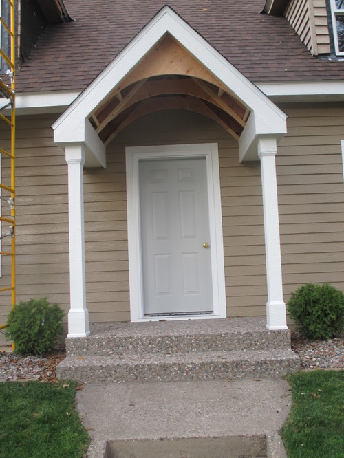 Portico interior roof front door and details on for Front door roof designs