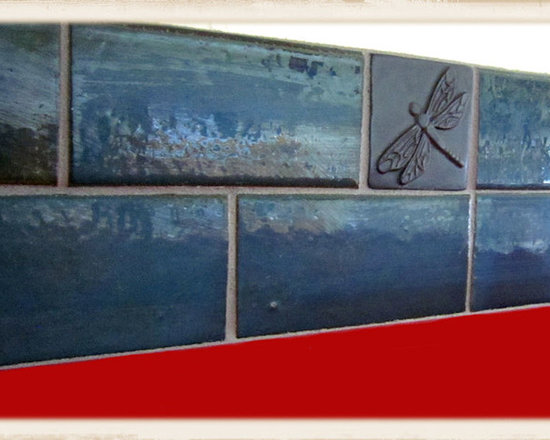 Backsplashes - Using handmade tile from the artists at Clay Squared to Infinity, we created this backsplash for our clients primary colored kitchen. This portion features a beautiful dragonfly relief.