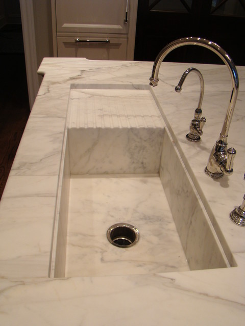 callacatta gold kitchen island with custom sink and drain