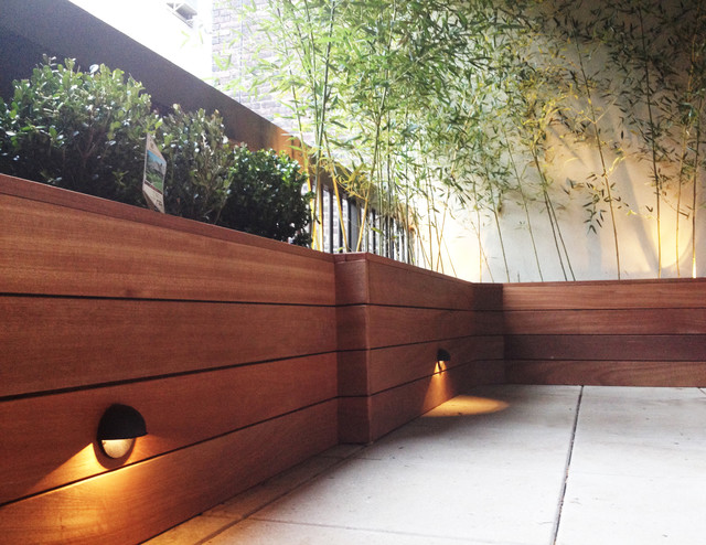 Terrace with custom planter box built with mahogany wood for Wooden garden planter designs