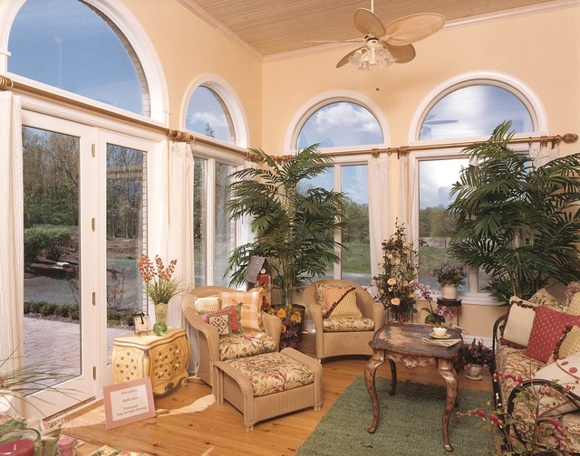 sunroom tropical-family-room