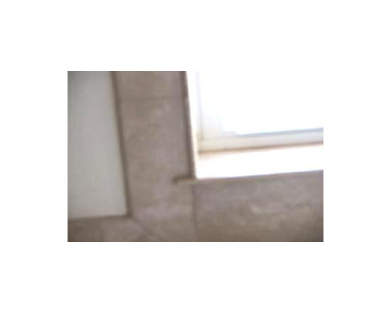 Close up view of Travertine tile trimmed kitchen window -