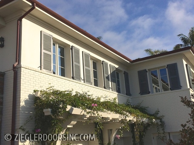 Louvered bahama style garage doors and shutters complement for Brentwood garage door