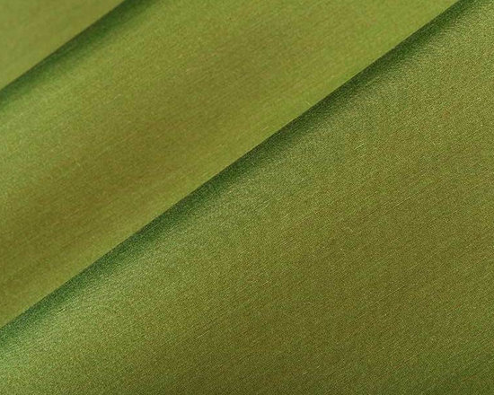 Poised Satin Drapery Fabric in Vert - Poised in Vert is a green satin drapery fabric made from a silk and linen blend. This drapery-weight plain contrasts the texture of linen on its face with the shimmer of silk satin on its reverse side, in a coordinating pair of colors. Its fine weave produces a wonderful hand, which is perfect for creating elegant window treatments, from roman shades to floor-length curtain panels. Its subtle palette includes pale hues derived from nature, perfect for adding quiet sophistication to traditional and modern rooms alike. Made in India from a blend of 58% Silk and 42% Linen. This fabric passes 2,000 double rubs on the Wyzenbeek abrasion test. Width: 55″