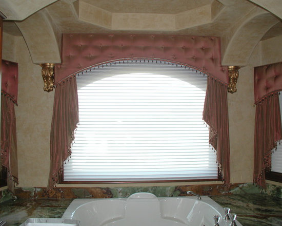 Cornice boxes - Upholstered cornice with decorative fabric covered buttons to match and cascades mounted beneath. Fabricated to fit around wall detail and shaped to match contour of window.