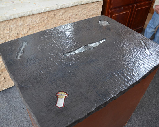Concrete Countertop With Vintage Harley Davidson Emblems - Amazing concrete island top embedded with vintage Harley Davidson items. The builder does custom designs using about anything you can think of!