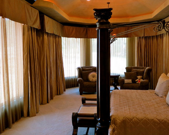 Bedroom - We worked with the interior designer to create these custom curtains. These drapes are all motorized with a Lutron drapery track. Each split-draw drape has a sheer behind it to allow in some light while maintaining privacy. The drapes can be operated with iPhone or iPad or controlled automatically with Savant's built-in astronomical clock.