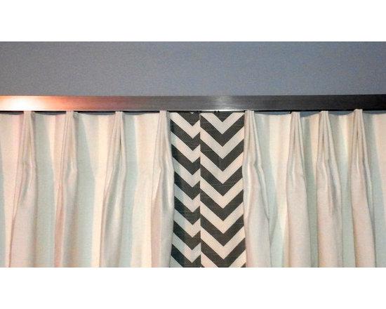Drapery Ideas - Fan pleated drapery on a modern decorative traverse rod.