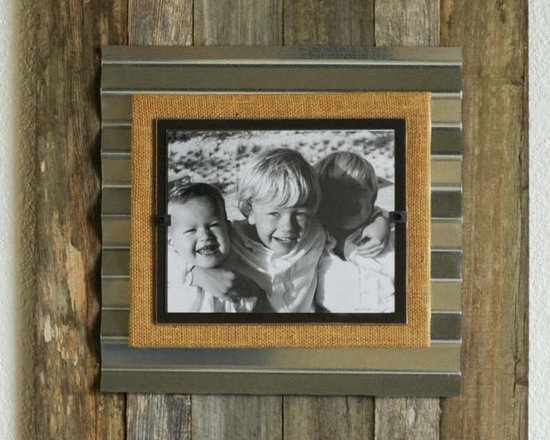 """Reclaimed Wood & Corrugated Frame - Large - These extra large frames are hand fashioned from reclaimed weathered wood, corrugated metal and burlap. Each holds an 8"""" x 10"""" picture and hangs vertically or horizontally. The front loaded picture frame with safe plexiglass is secured by simple clamping system for easy picture changes. Wood type (typically weathered pine, hardwood or cedar ), degree of weathering, grain, knots, coloring, markings, slat widths, textures and overall dimensions will vary as each piece of wood is different...making each frame a """"one of a kind"""" piece."""