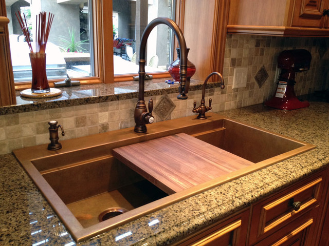 Signature top mounted copper sink with black walnut cutting board and Waterstone kitchen-sinks