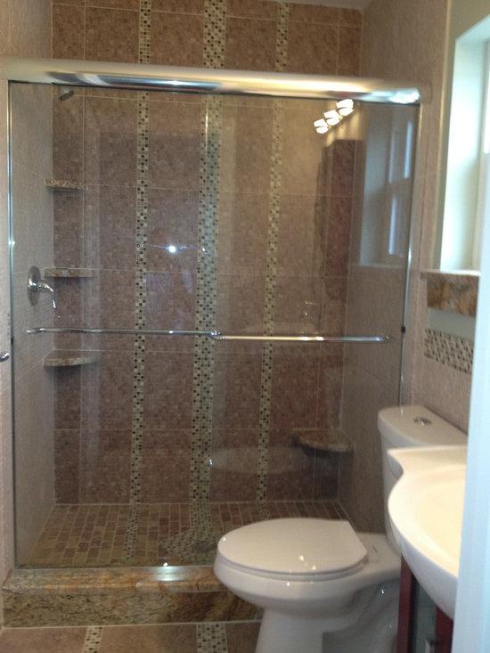 Sliders - Frameless shower slider with 2 towel bars. John Tallarida