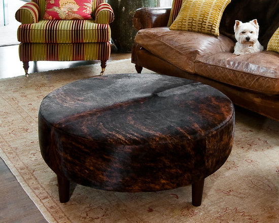 Gorgeous Creatures New Zealand - Round dark exotic stripe ottoman - This lovely round ottoman was made from a gorgeous cowhide that was the perfect colour for the room. Made to the clients specifications including the tall round wood legs.