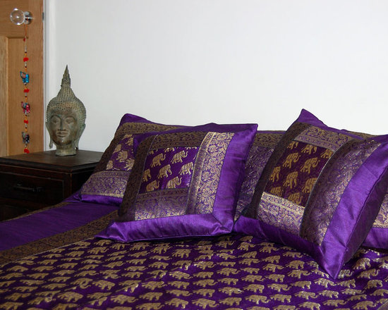 Purple elephant design Indian bedspread set - Embroidered bedspread set with two matching pillowcases and two cushion covers. Stitched in purple and gold thread with an elephant design and bordered with silk brocade, this elegant bedset will look stunning in any bedroom. Suitable for a double bed.
