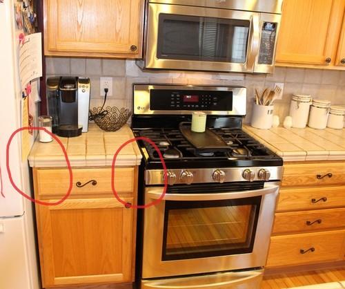 Space / overhang between countertop and stove / fridge