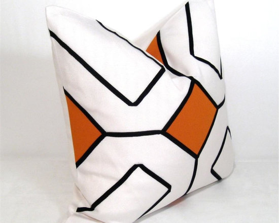 Orange on White Arabesk Outdoor Decor Cushion - Several pieces of Orange Sunbrella fabric are fused and appliqued onto Eggshell Sunbrella Canvas and trimmed in a geometric lattice motif. Fully finished inside with a weatherproof reinforced zippered closure for easy machine washing. Cover or bring indoors when not in use for longevity.