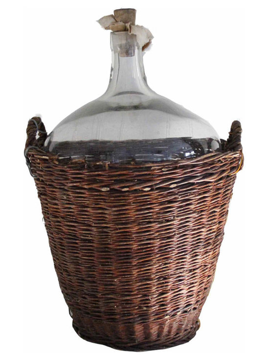 Wine Bottle & Basket - A extra large vintage wine bottle and carrier found in France. Wonderful large glass wine vessel with bubbled wavy glass and original wooden stopper.