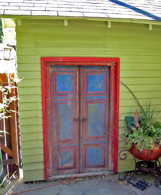 Salvaged javanese teak door as detached garage entry door for Recycled windows and doors