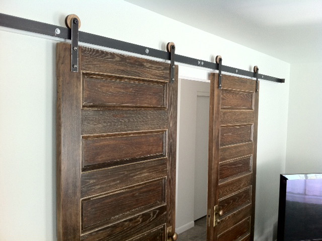 Simple wooden double bed - Modern Barn Door Hardware