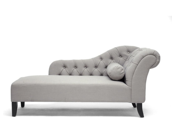 Baxton Studio - Baxton Studio Aphrodite Tufted Putty Gray Linen Modern Chaise Lounge - Peace of mind is not hard to find when you can retreat to the comfort of the Aphrodite Modern Chaise Lounge. This queenly design does not skimp on details: a scrollback, plentiful button tufting, and a bolster pillow are featured. Construction is done in China with a wooden frame, foam cushioning, and neutral putty gray linen upholstery that lends itself well to a variety of decor. Black wooden legs with non-marking feet finish it off. Some assembly is required for this designer chaise lounge, which must only be spot cleaned.