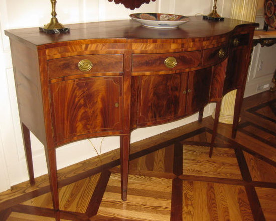 """#6486-1 New England Hebblewhite Sideboard - #6486-1 This inlaid New England Hepplewhite serpentine sideboard is an important prototype, as it is within this basic form that the most handsome ones are made. The strong serpentine shape is immediately attractive and it rests on the tallest of slender line inlaid legs ending in bracelets. The maker's difficult art was to take this massive rectangle on its side and prop it on the most slender, tall legs making it all elegant. W. 72"""", d. 28"""", and h.42"""". Circa 1785."""