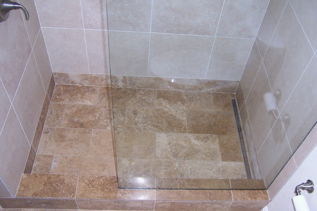 Travertine and porcelain shower with linear drain (after glass installation) tropical-bathroom